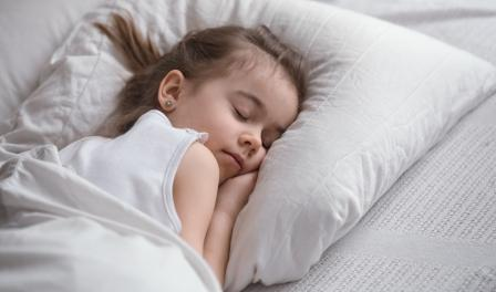 At what age does a child need a pillow